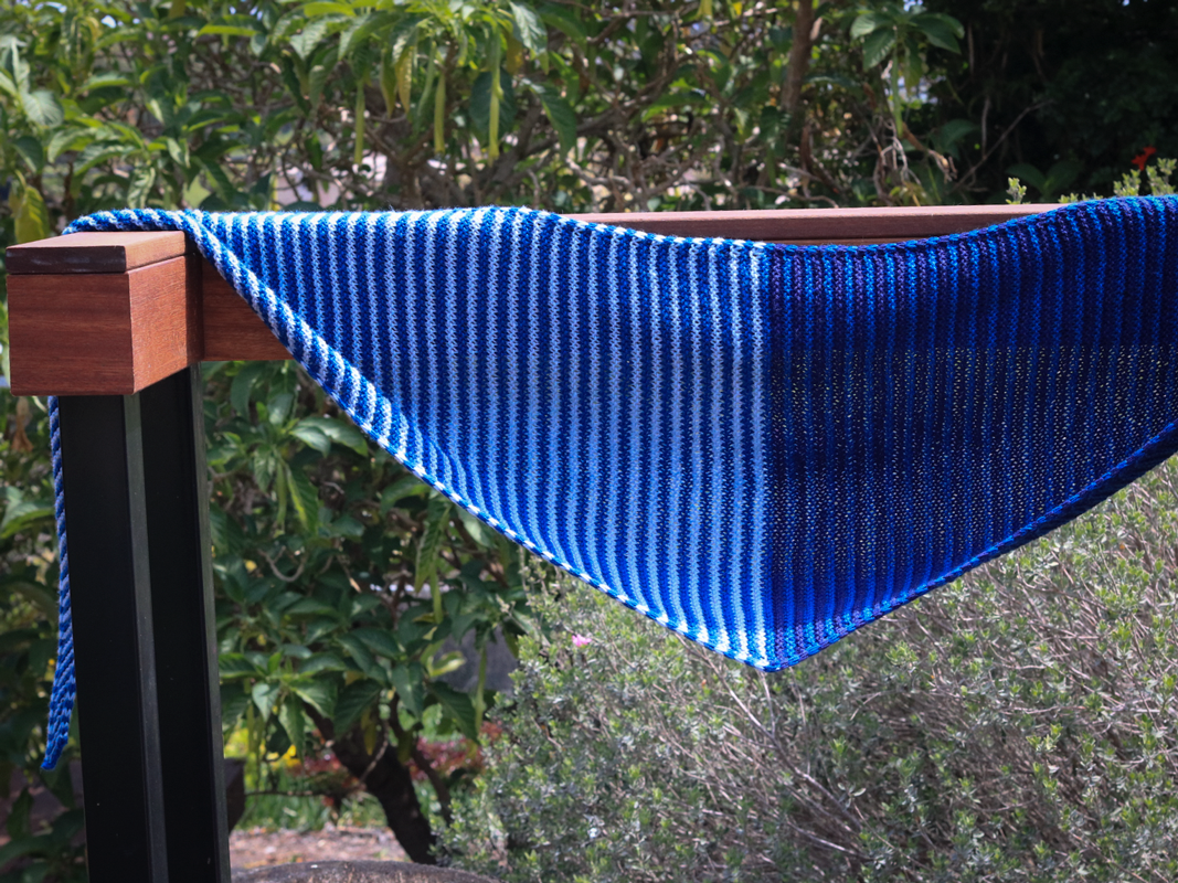 Something About Phoenix  shawl knitting pattern with blue tones