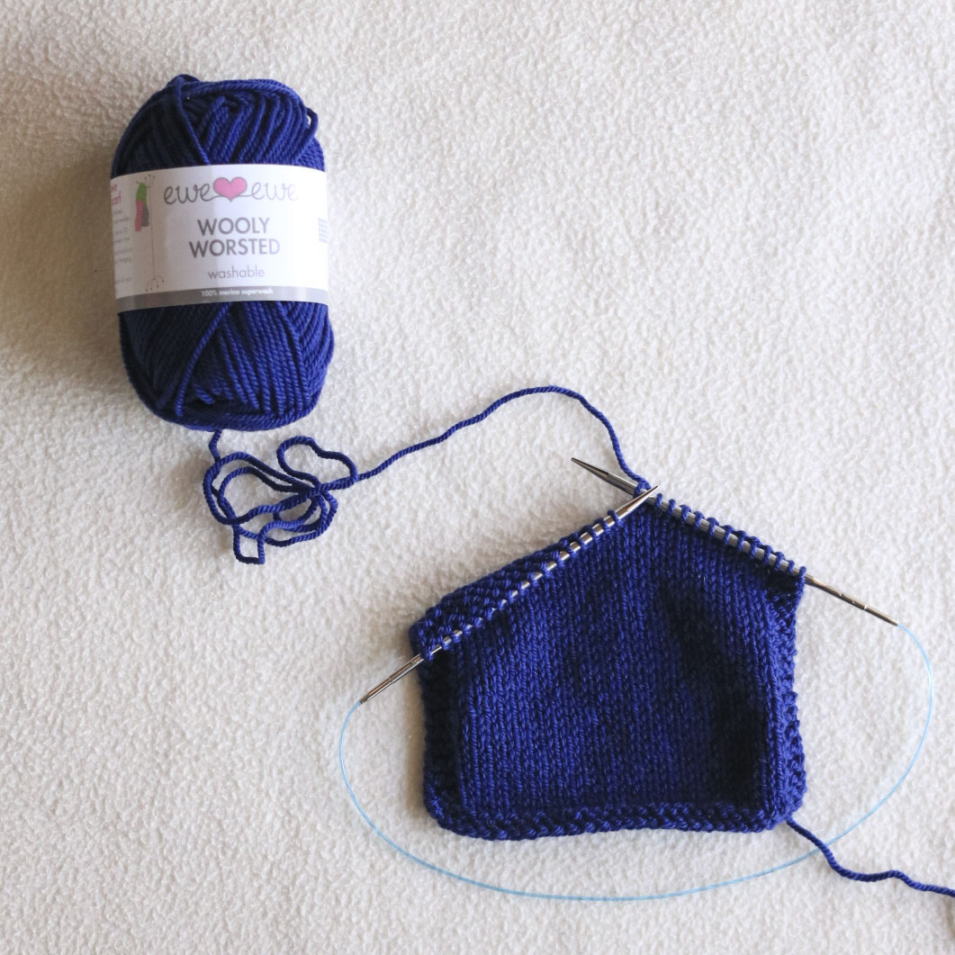 Wooly Worsted yarn  in color Midnight Blue for the Foxtrot Cardigan 4 Day KAL.  Shop yarn kits.