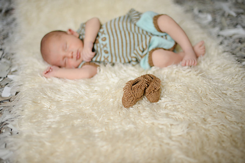 Welcome Mocs , part of the New Guy layette set on Ravelry