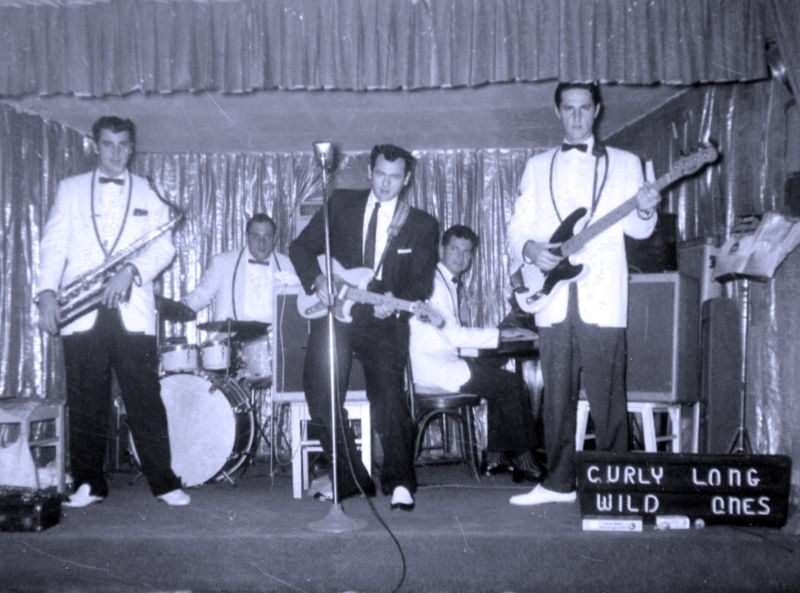 Curly Long and the Wild Ones with Texas Brass members Vernon Drozd (left) and Brian McWhirter (center).