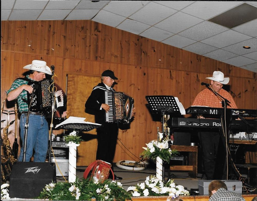 Tim jams with Dujka Brothers at wedding reception