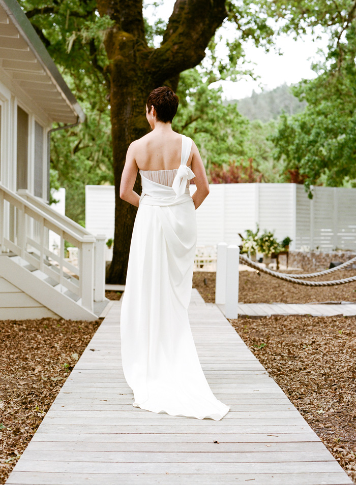 The back of the bride's dress: long, simple, and white. Everything a wedding dress should be.