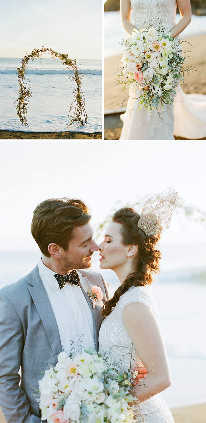 Floral arbor on the beach, bride with gold lace hairpiece kisses groom; Sylvie Gil Photography