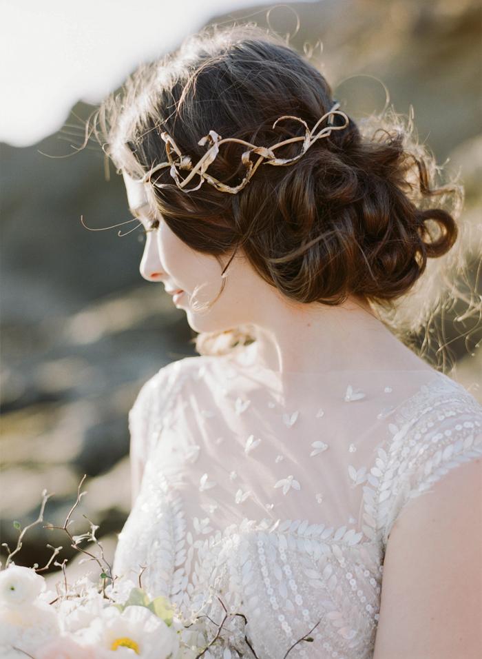 Bride in sheer, sequined gown, twisty gold hairpiece; Sylvie Gil Photography