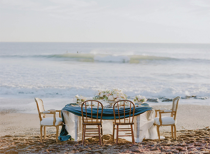 Draped linen reception tablecloths on the beach in California; Sylvie Gil Photography