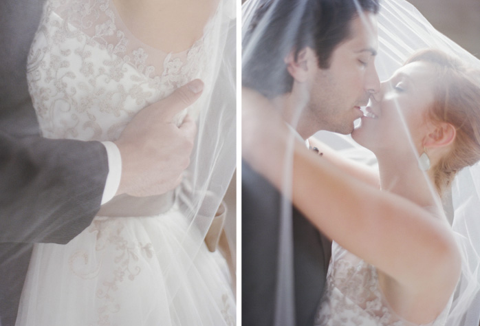 Bride and groom kiss under lace veil at San Francisco City Hall wedding;  Sylvie Gil Photography