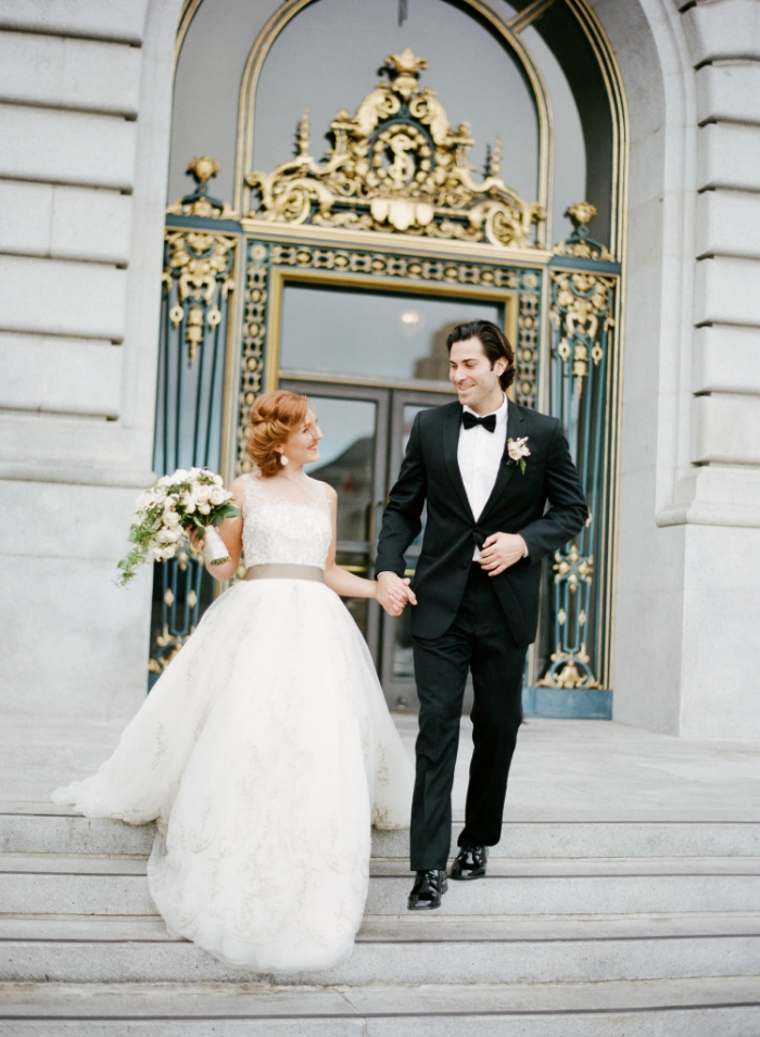 Just married couple outside San Francisco City Hall, tulle and lace ball gown; Sylvie Gil Photography