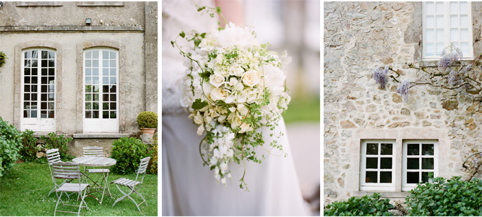 Stone facade of Normandy chateau growing with vines and wisteria; Sylvie Gil Photography