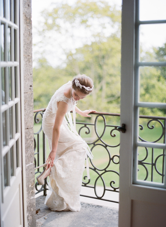 Bride with nude stiletto pumps and sheer lace wedding gown; Sylvie Gil Photography