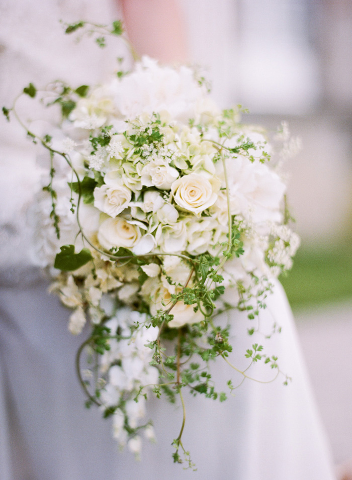 White rose wedding bouquet decorated with baby's breath and vines;  Sylvie Gil Photography