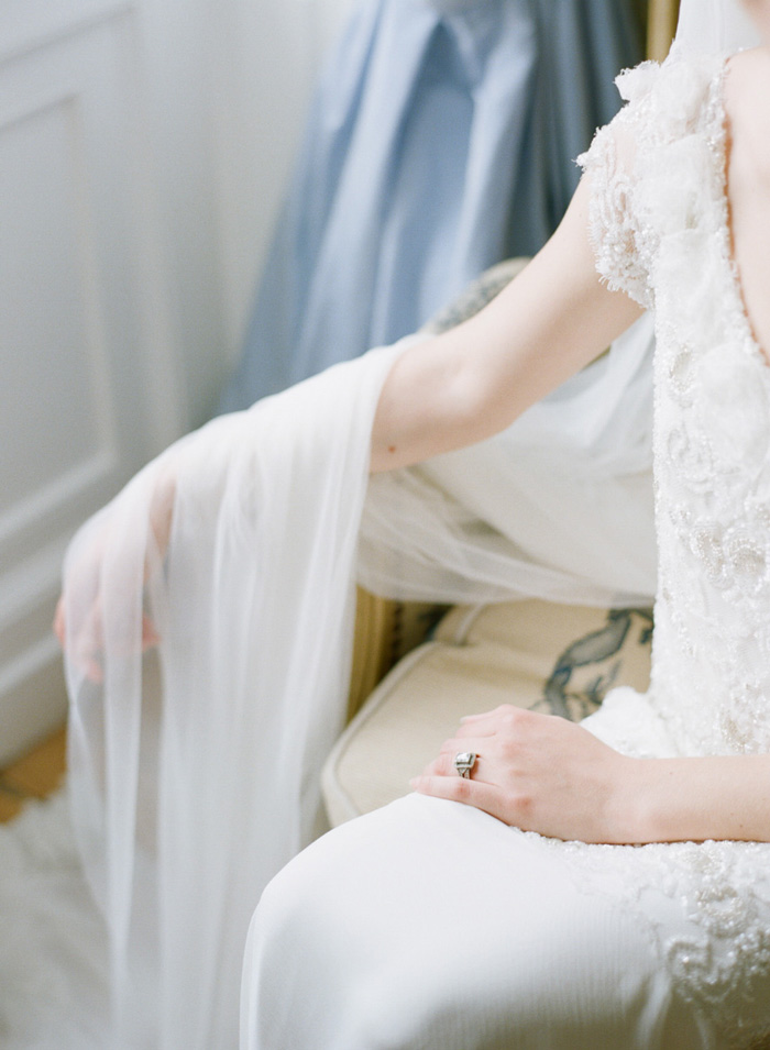 Bride with vintage ring and sheer veil in Normandy chateau; Sylvie Gil Photography