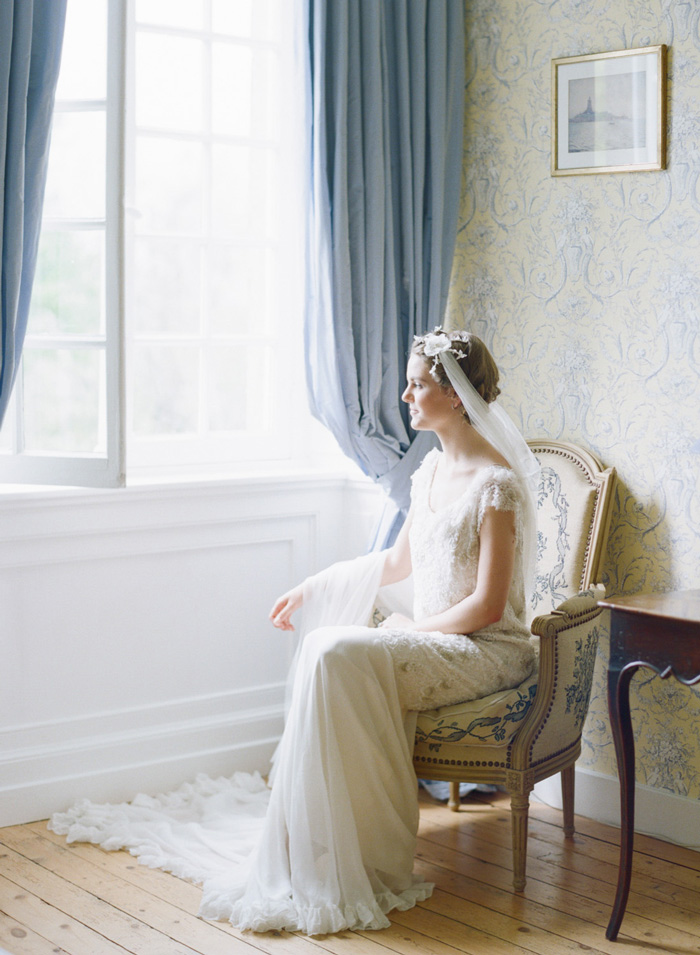 Bride with ruffled edge lace gown and pinned lace veil; Sylvie Gil Photography