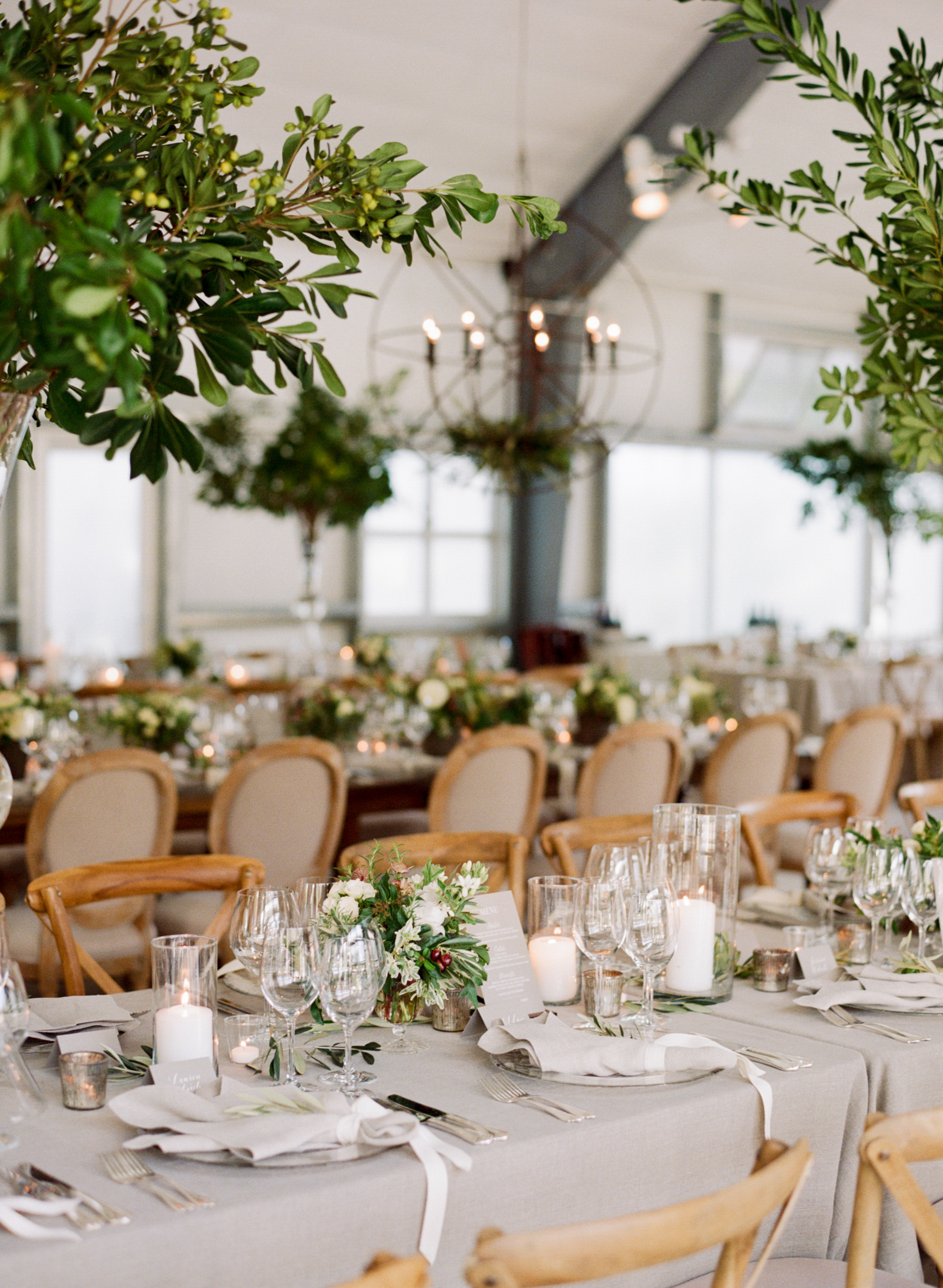 Small orange tree centerpieces, elegant linen table settings; Sylvie Gil Photography
