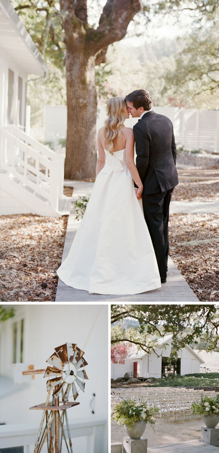 Bride and groom kiss holding hands, rusting windmill decoration, ceremony seating under oak trees; Sylvie Gil Photography