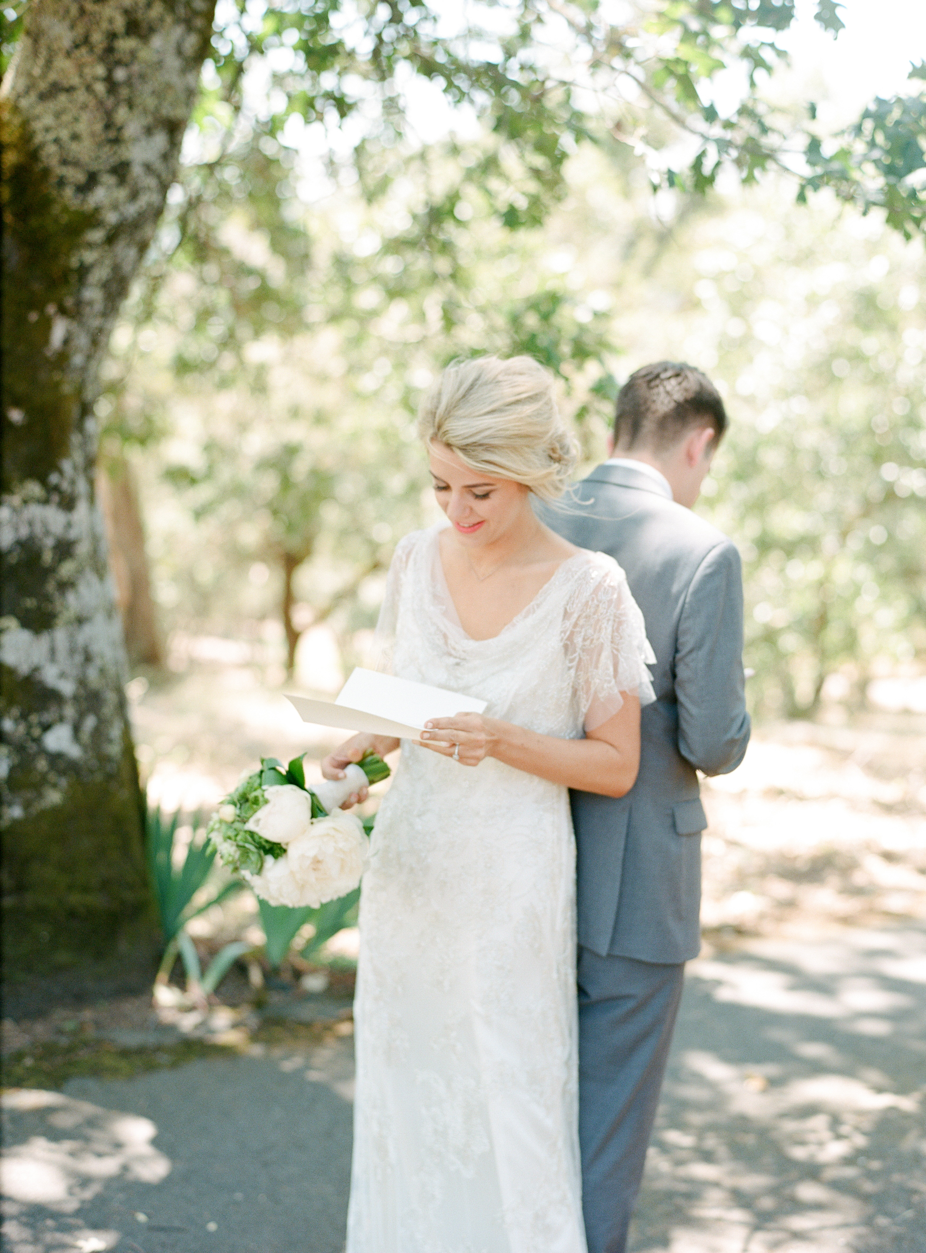 Sylvie-Gil-film-destination-photography-Kunde-winery-Napa-Valley-elegant-shabby-chic-first-look-letters
