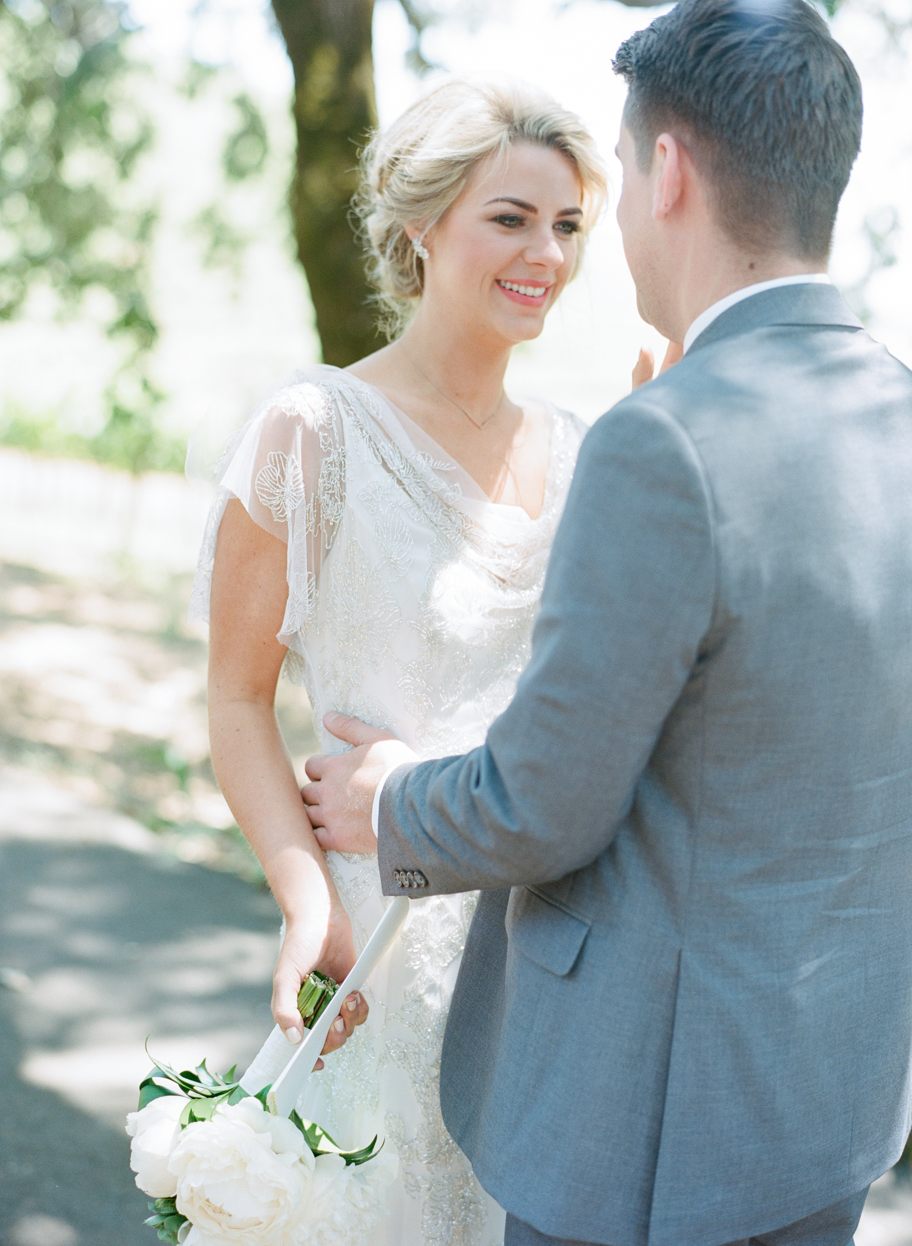 Sylvie-Gil-film-destination-photography-Kunde-winery-Napa-Valley-elegant-shabby-chic-bride-groom-first-look