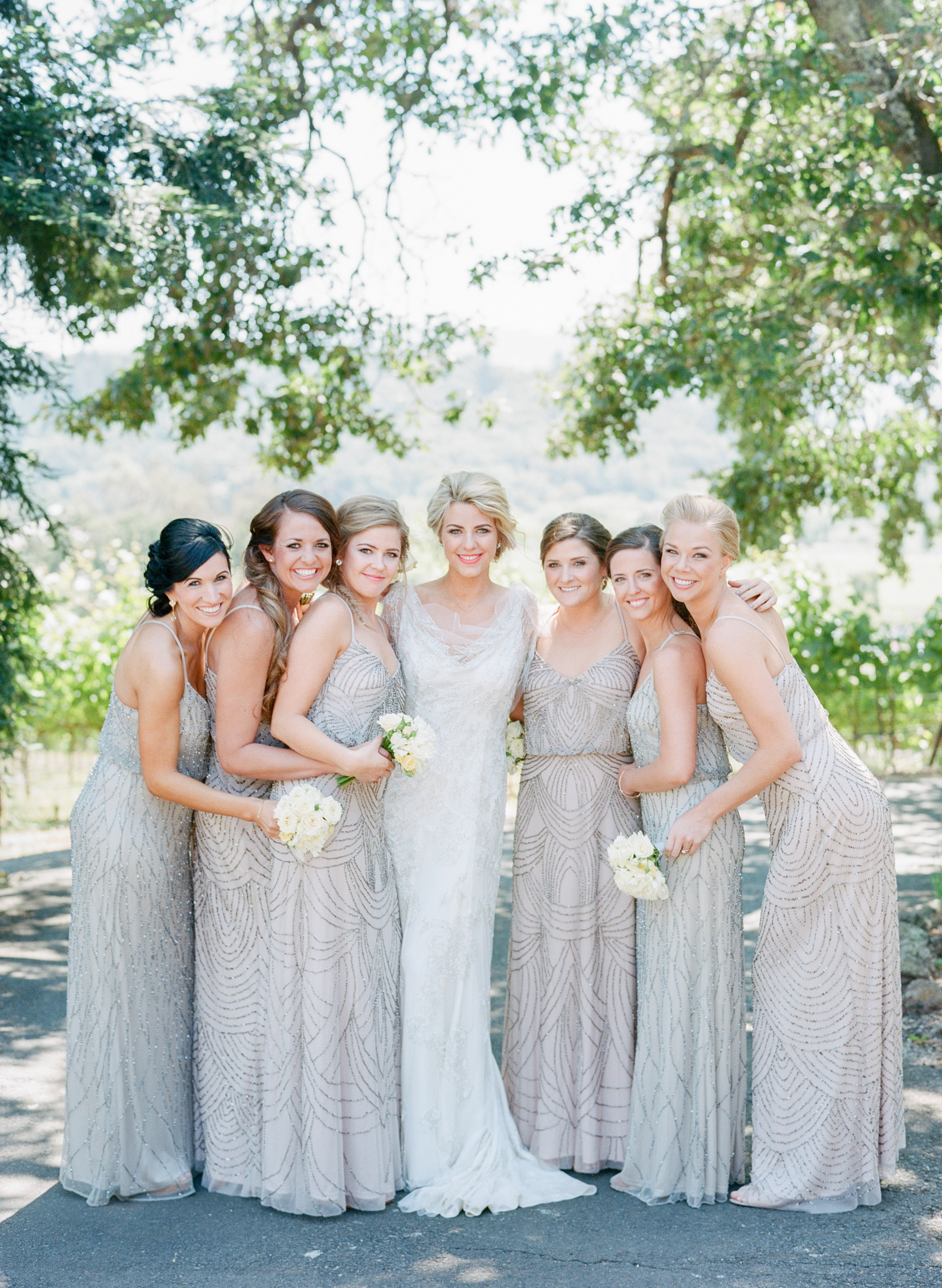 Sylvie-Gil-film-destination-photography-Kunde-winery-Napa-Valley-elegant-shabby-chic-bride-bridesmaids-lean-in