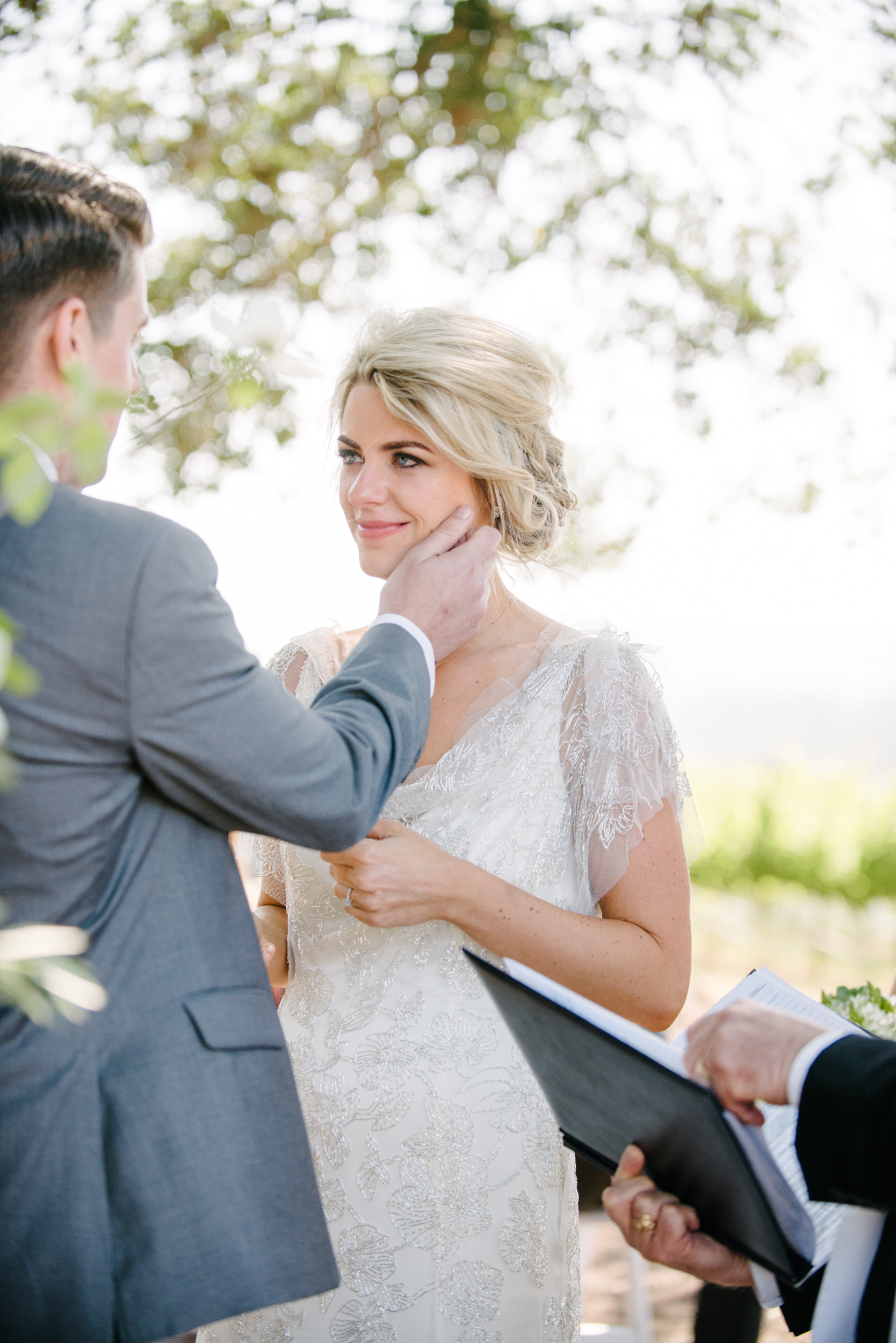 Sylvie-Gil-film-destination-photography-Kunde-winery-Napa-Valley-elegant-shabby-chic-ceremony-groom-touches-bride-face