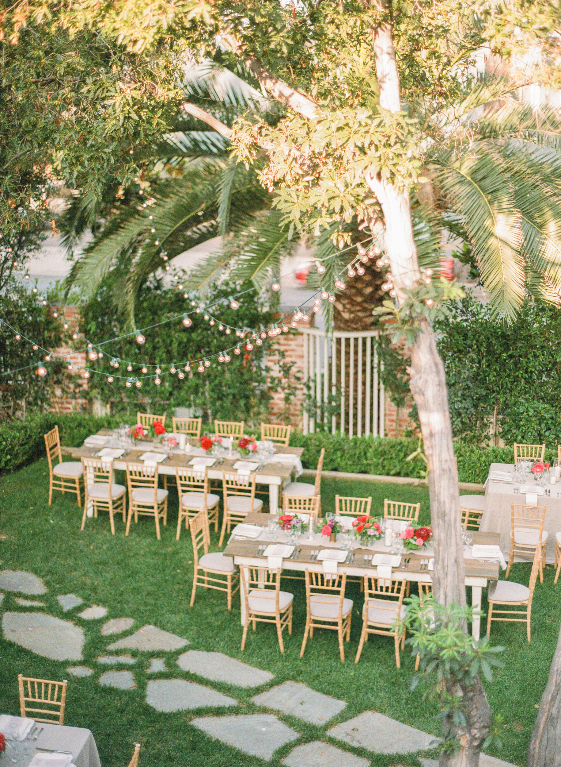 Sylvie-Gil-Lombardi-House-LosAngeles-colorful-wedding-outdoor-reception-white-barn-string-lights-palm-trees