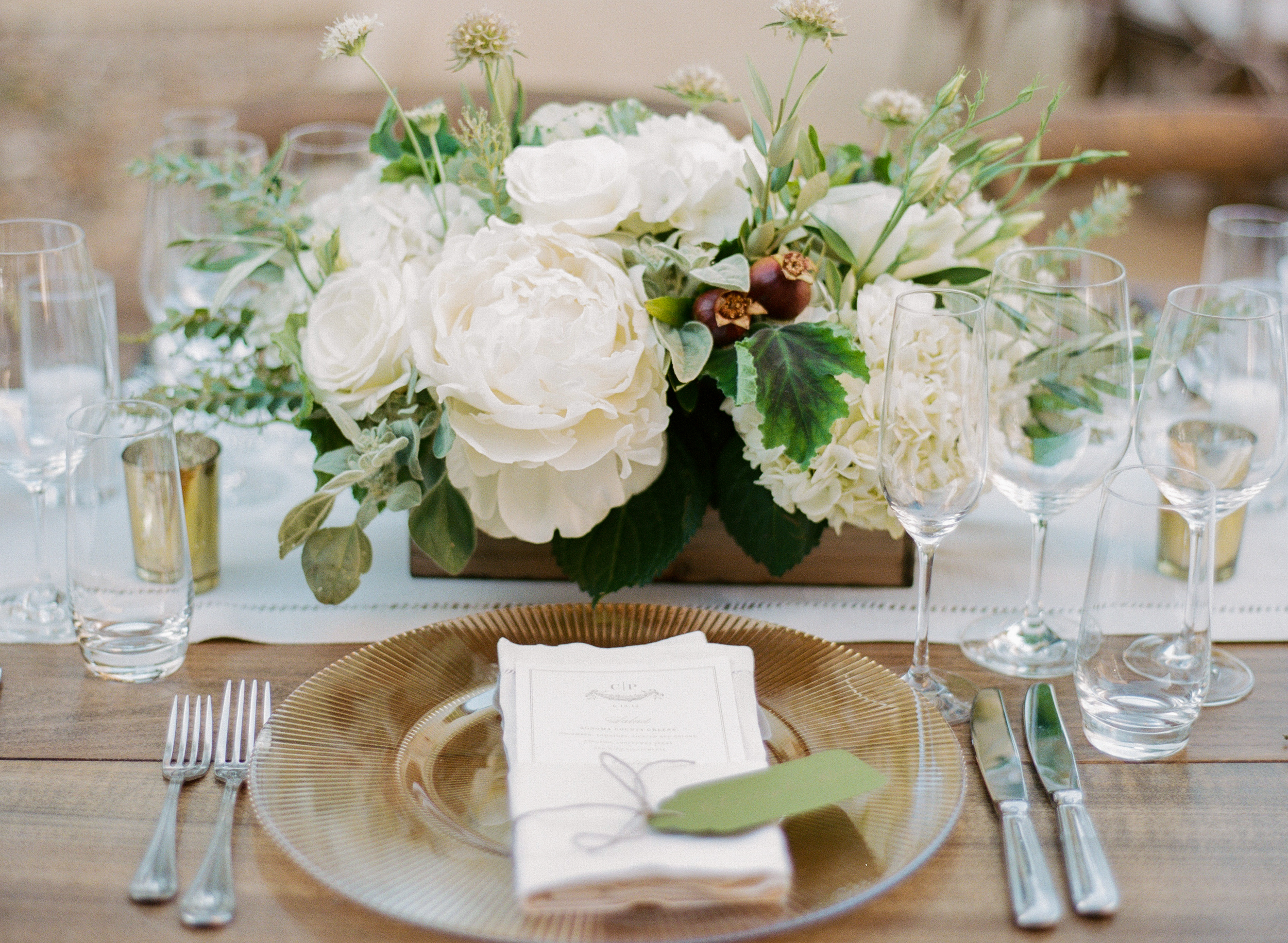 An elegant place setting at the outdoor reception tables; photo by Sylvie Gil