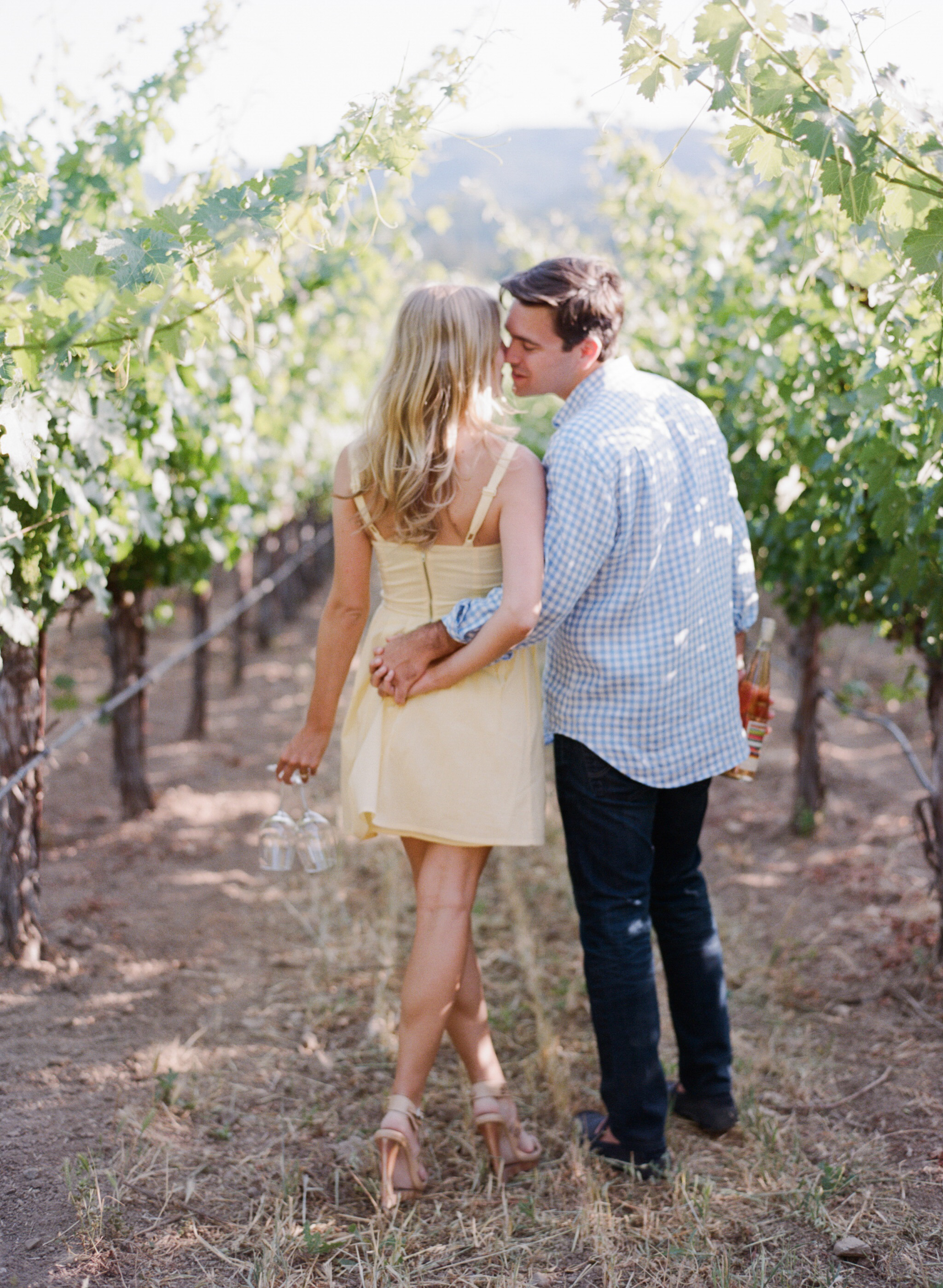 An intimate moment between two fiancees in a Napa Valley vineyard  during an engagement session with Sylvie Gil.