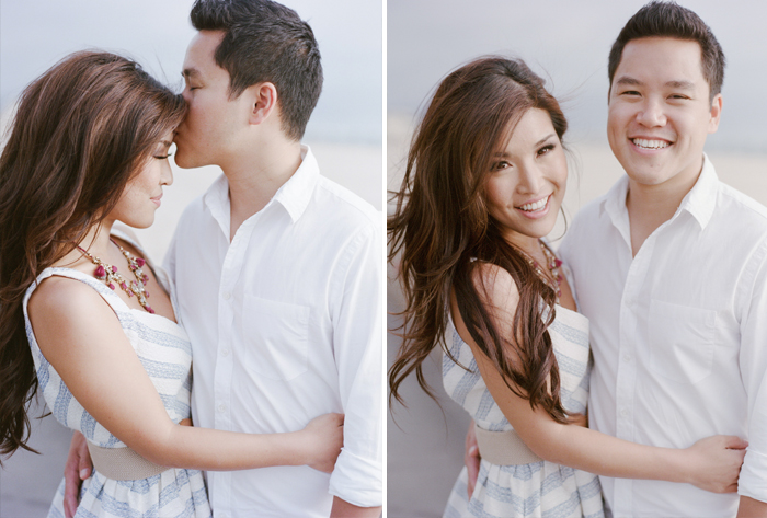 Couple embraces during a Hermosa Beach engagement session with Sylvie Gil.