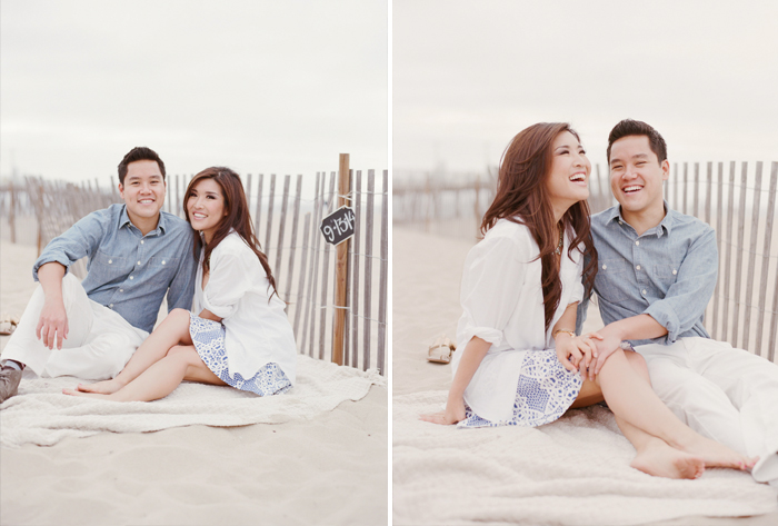 Couple relaxes on a blanket in the sand at Hermosa Beach during an engagment session with Sylvie Gil.