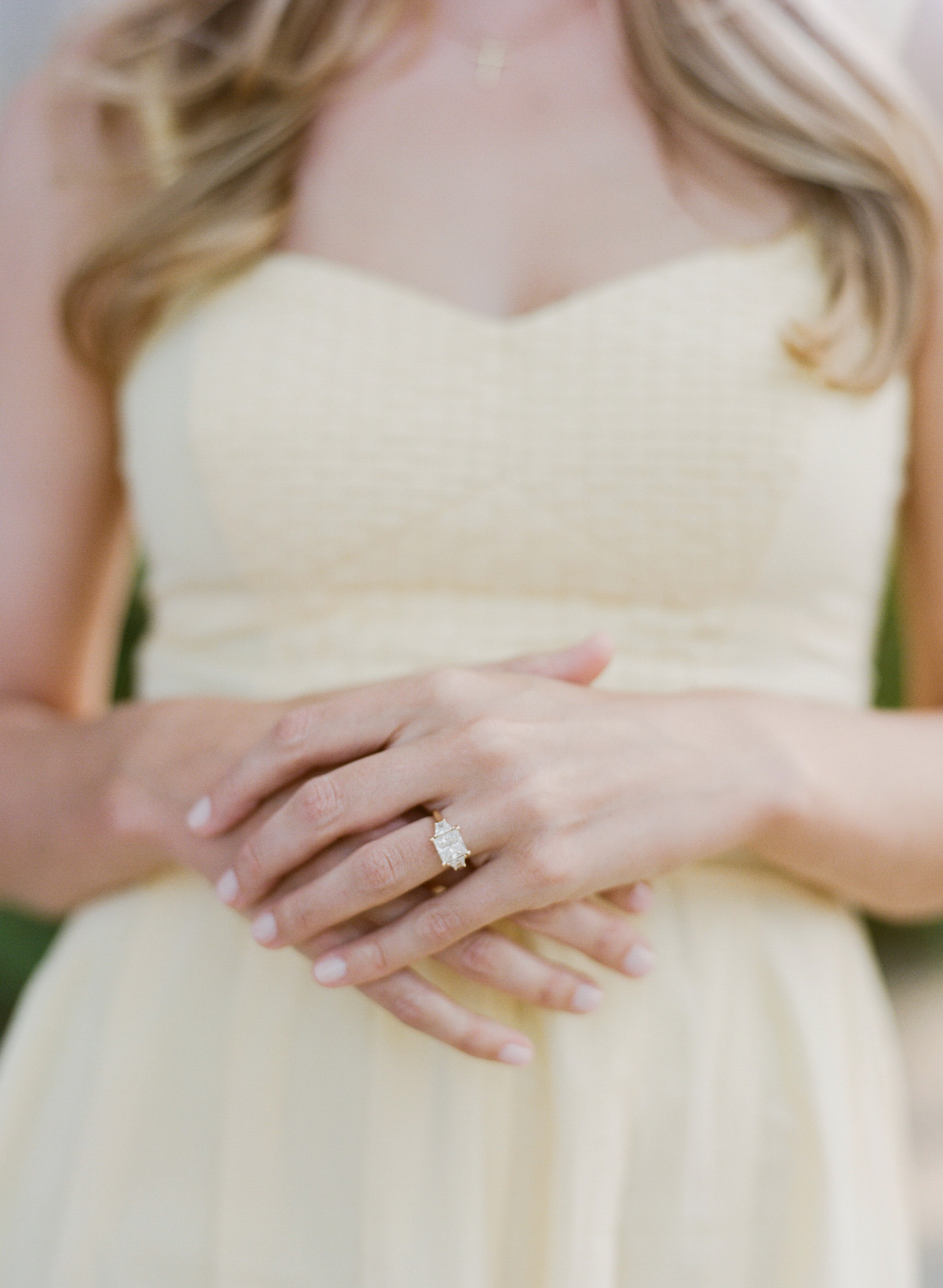 A bride-to-be shows off her engagement ring  during an engagement session with Sylvie Gil at a Napa Valley winery.