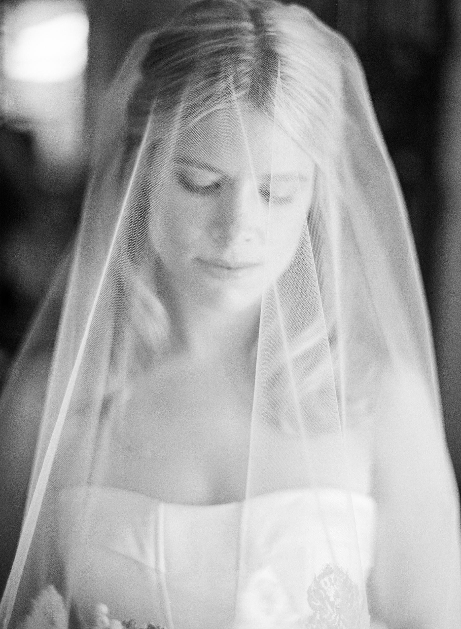 An intimate shot of Sarah, wearing her veil and beautiful Carolina Herrera gown before the wedding ceremony; photo by Sylvie Gil.