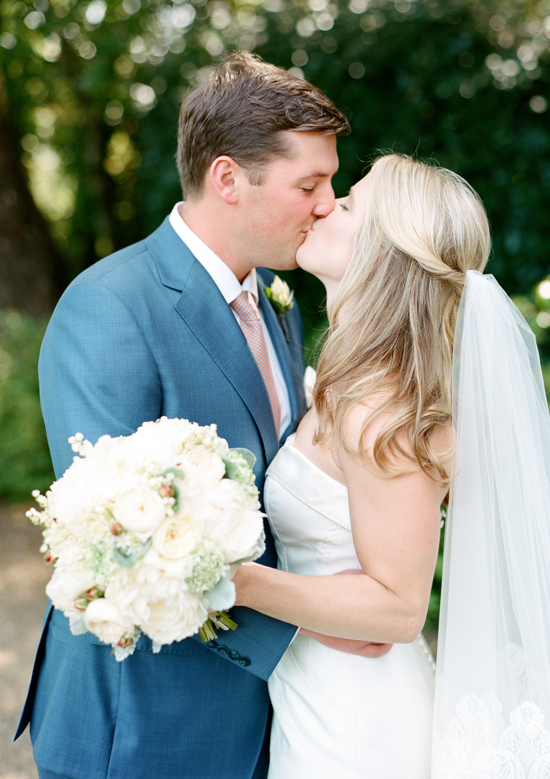 Sarah and James share a kiss before the ceremony; photo by Sylvie Gil
