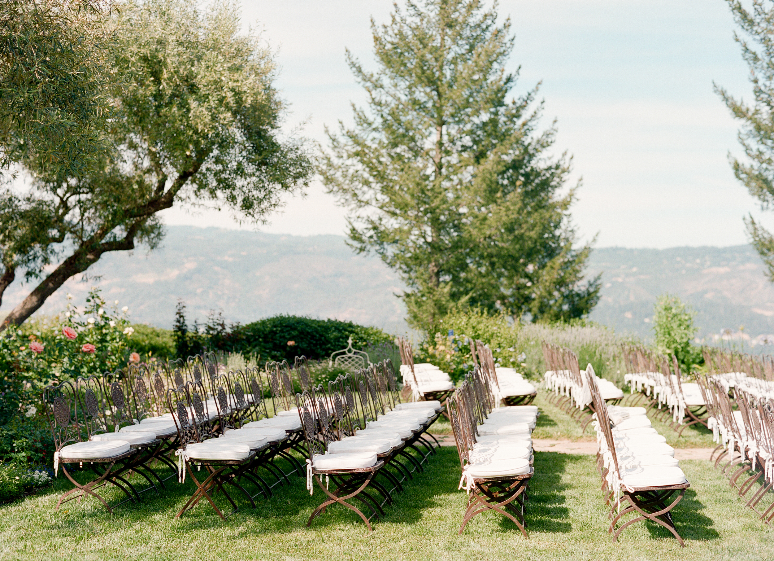 The outdoor ceremony seating overlooks beautiful Napa wine country; photo by Sylvie Gil