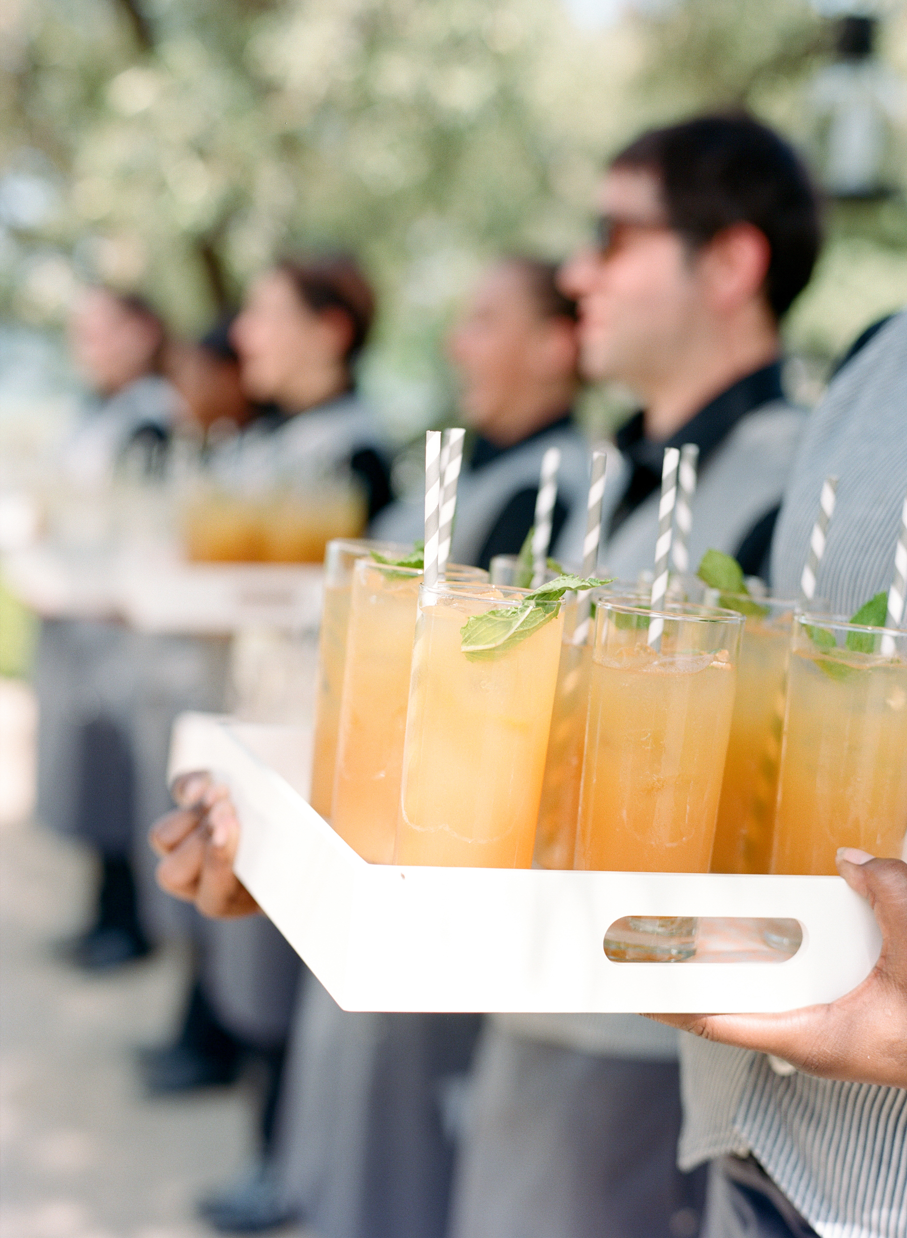 Paula Leduc Caterers hold trays of refreshments for the reception; photo by Sylvie Gil