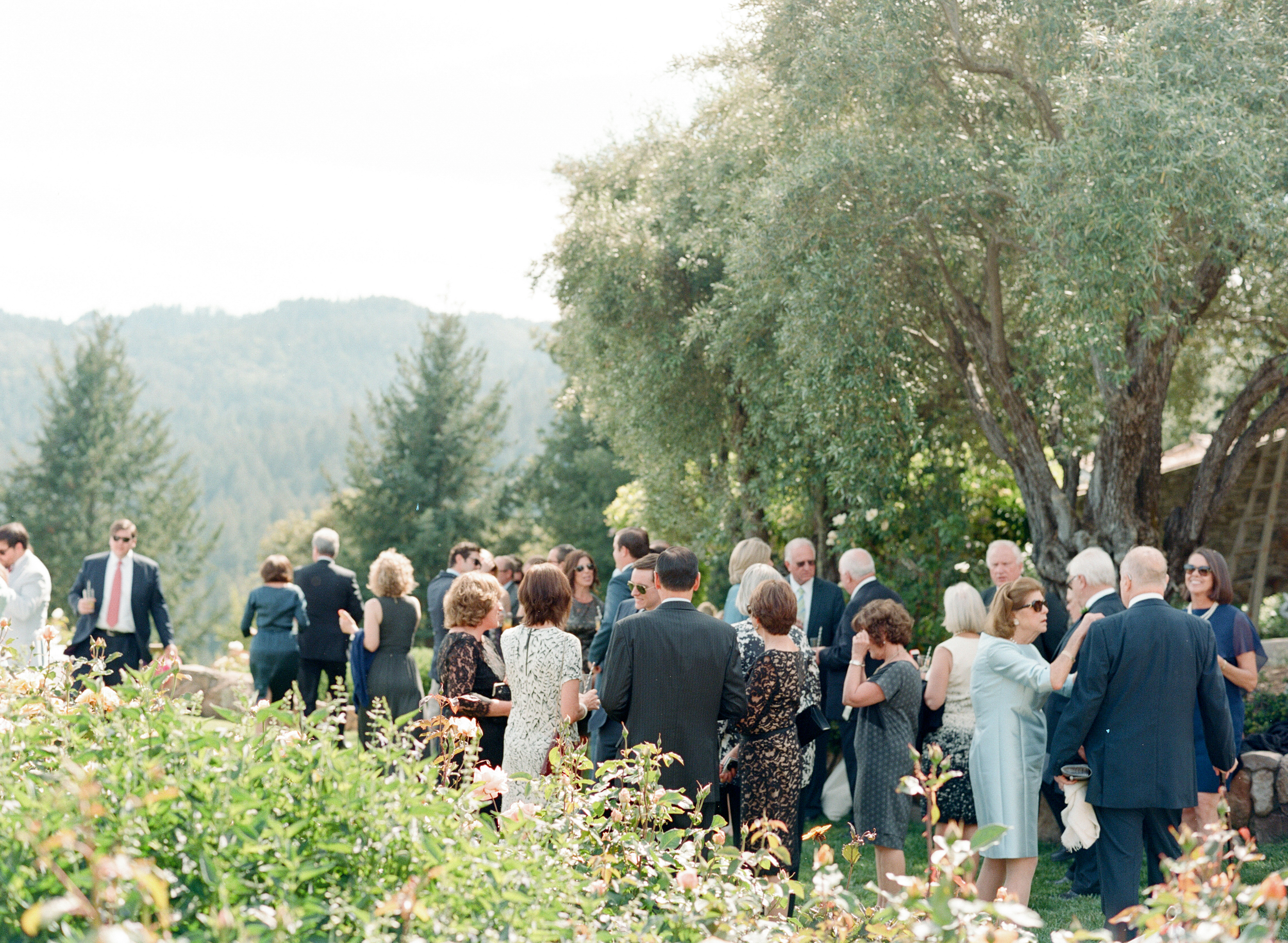 The garden setting for the outdoor reception provided an airy summer feel to the day; photo by Sylvie Gil