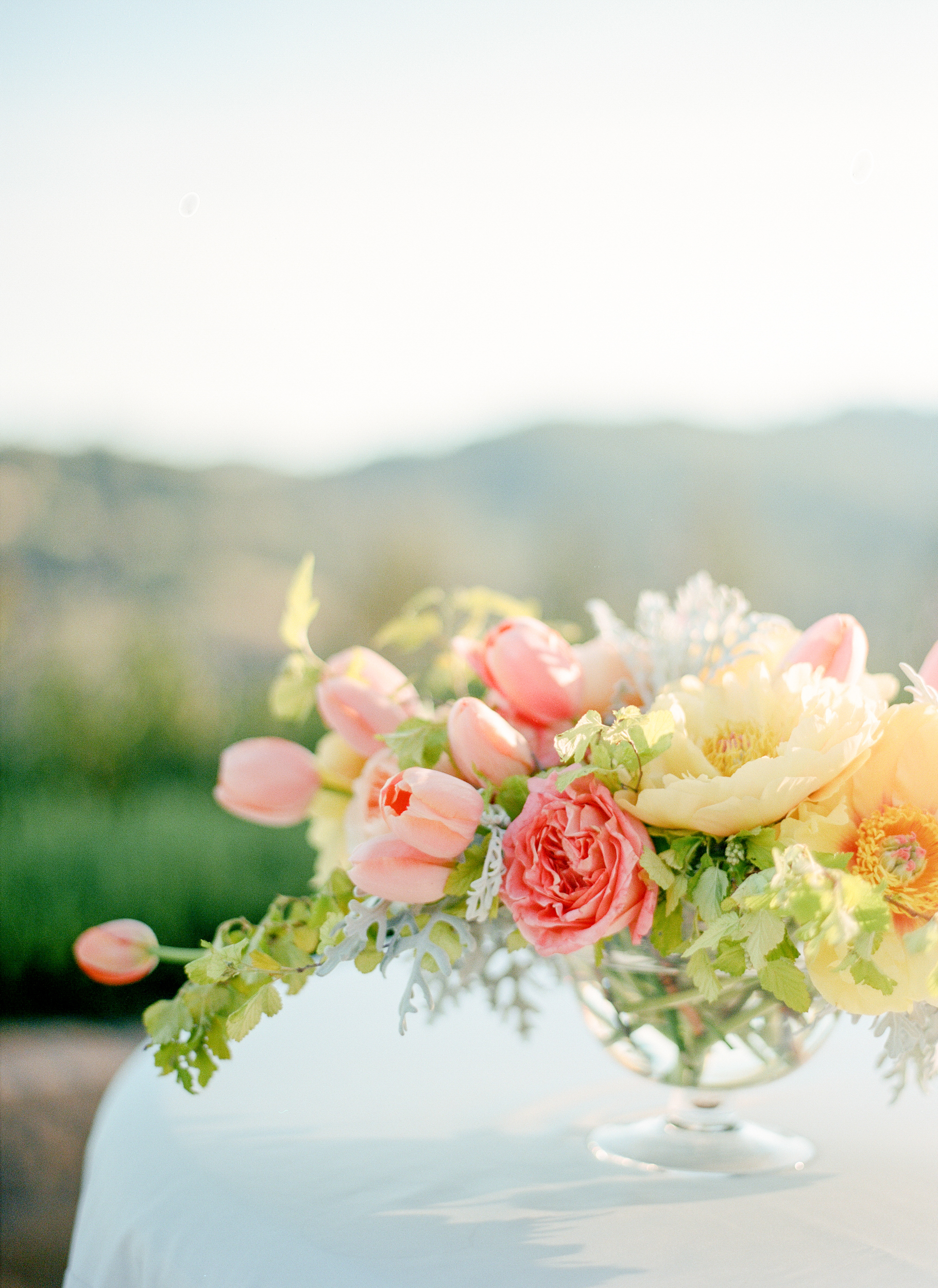 Colorful pastels highlighted the ceremony, especially in the beautiful floral centerpieces, by Kathleen Deery; photo by Sylvie Gil.