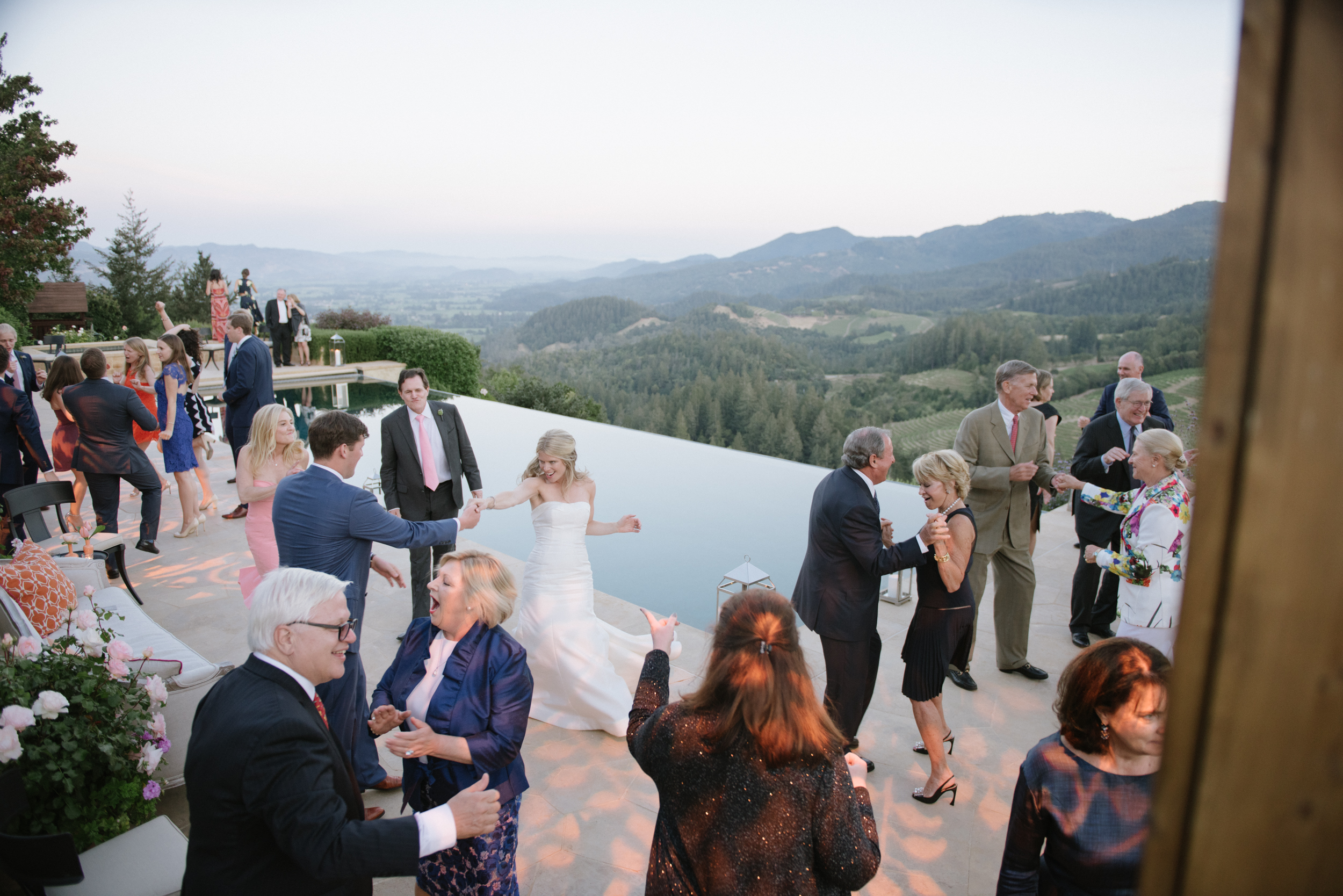 Dancing by the pool with the view of the Napa countryside continues into the night as guests celebrate Sarah and James' special day; photo by Sylvie Gil