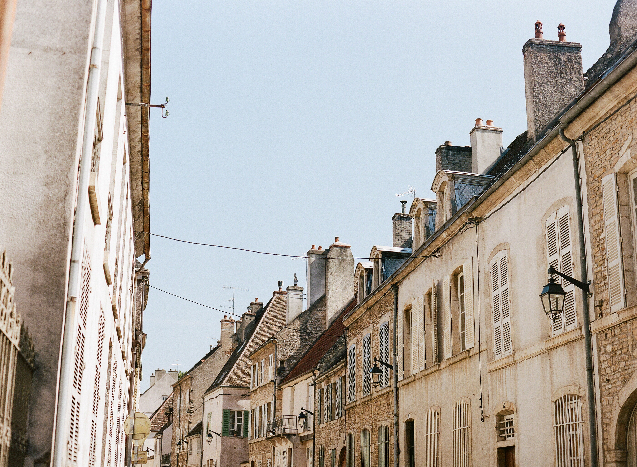 Rooftops in an alley in Lyon; photography by Sylvie Gil