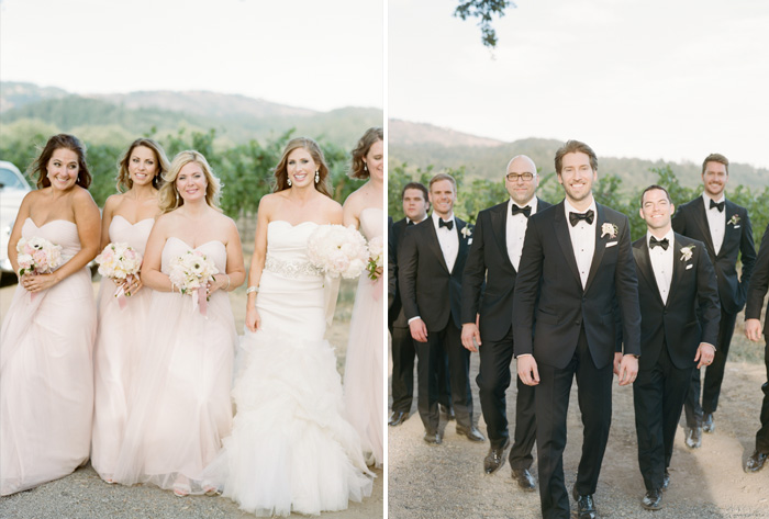 The bridesmaids in blush and groomsmen in dapper black tuxedos walk toward the camera during a bridal party shoot; photo by Sylvie Gil