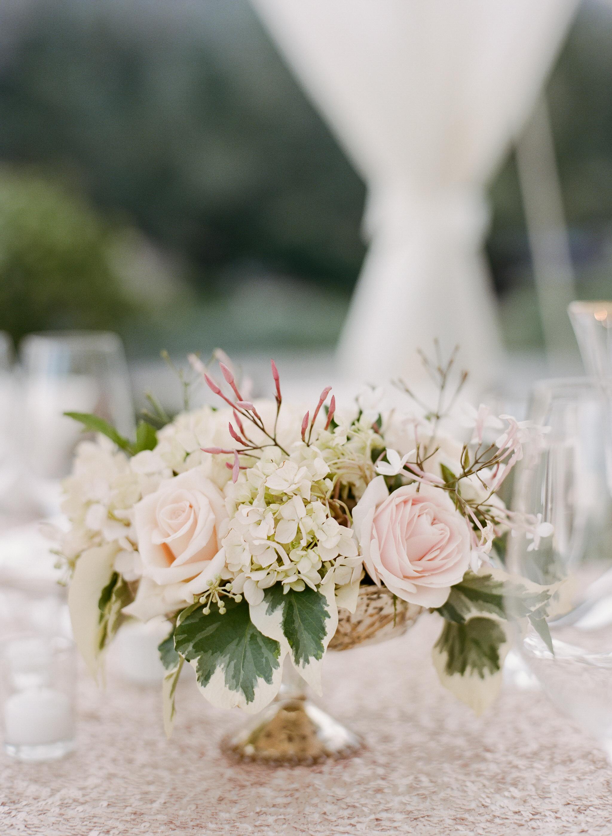 A subtle accent floral arrangement combines hydrangeas with blush roses; photo by Sylvie Gil