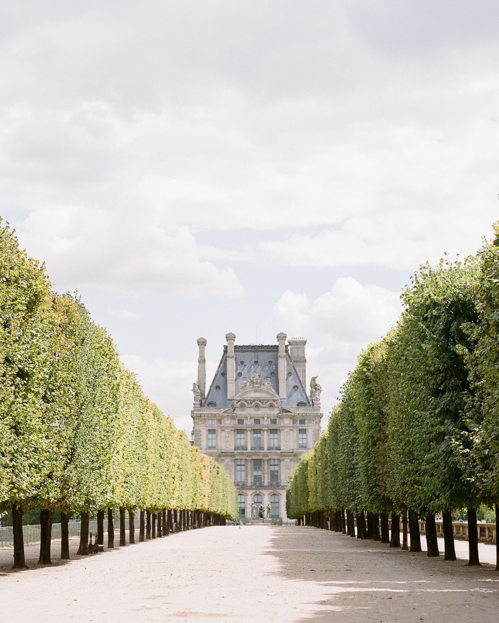 Looking up a gravel path toward a chateau in Paris; photo by Sylvie Gil