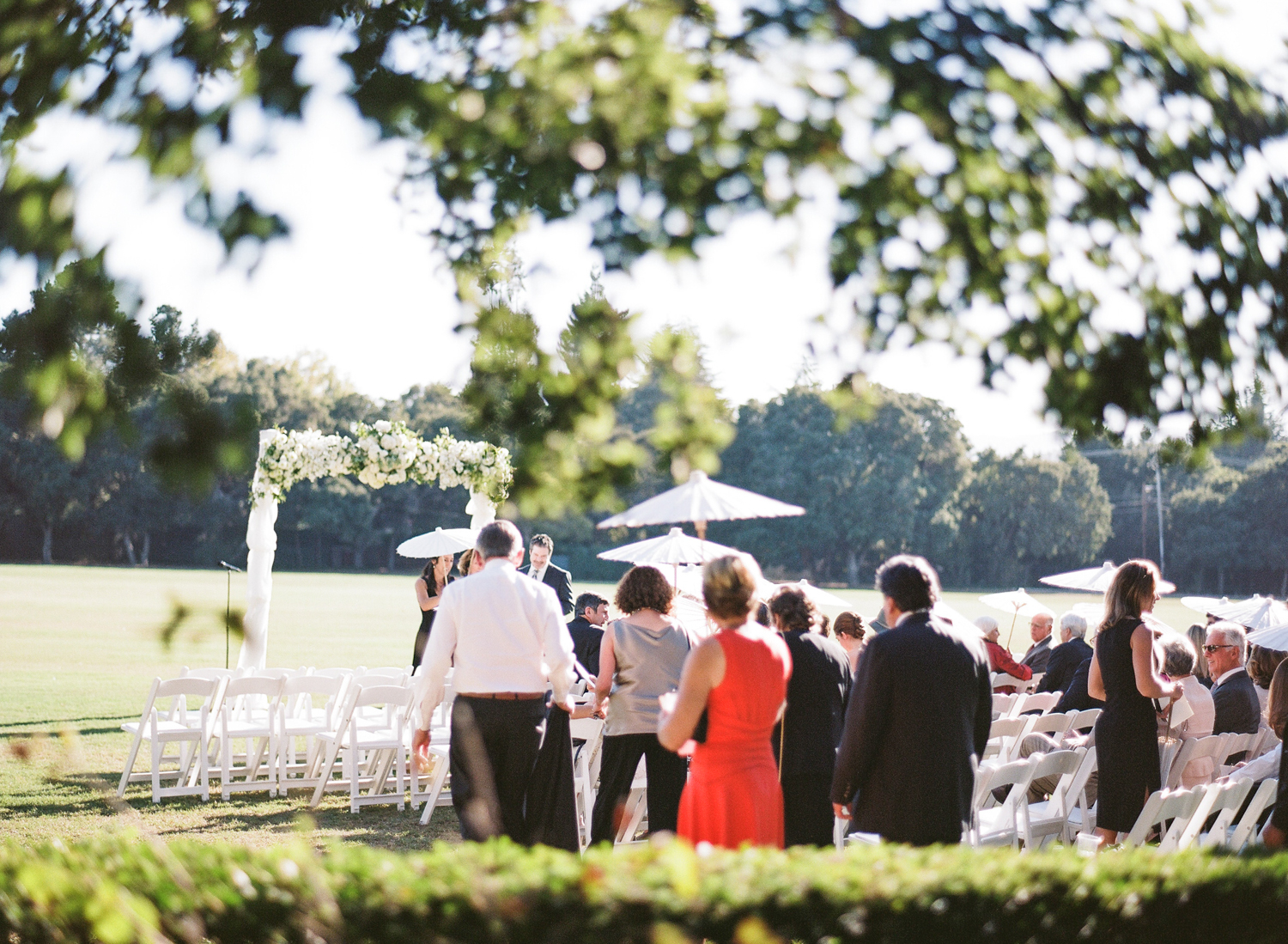 Guests arrive to the open outdoor ceremony space; photo by Sylvie Gil