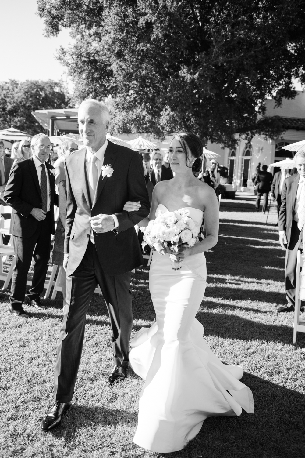 Caroline's father walks her down the aisle during the outdoor ceremony to give her away; photo by Sylvie Gil
