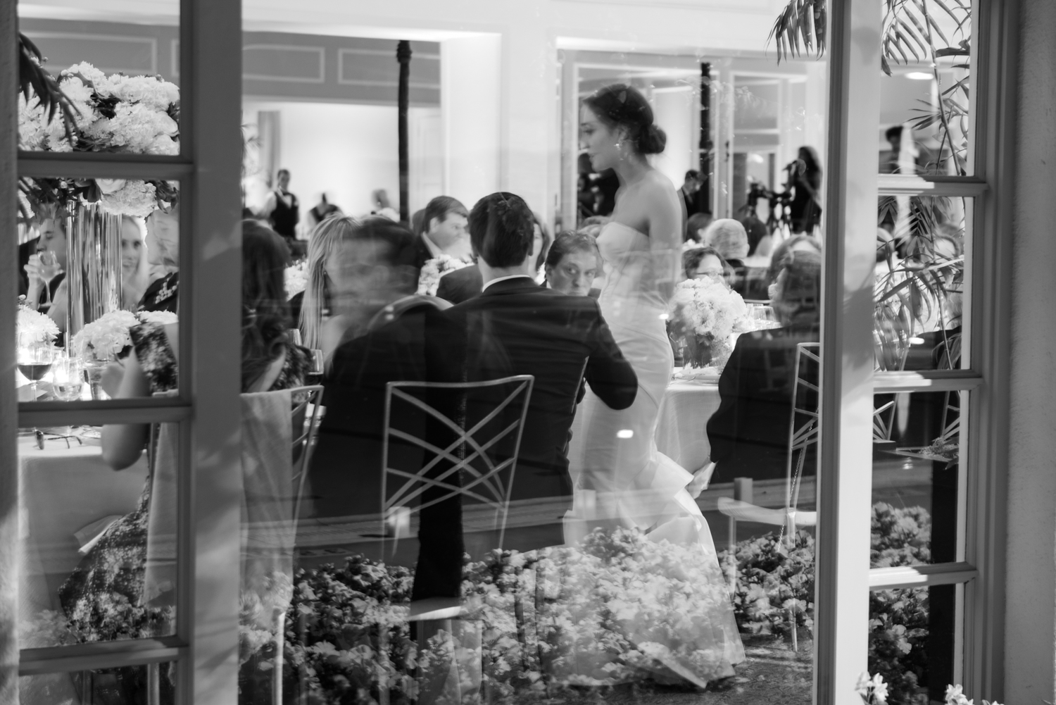 An artsy look in through the reception hall windows as Caroline meets the guests at her wedding; photo by Sylvie Gil