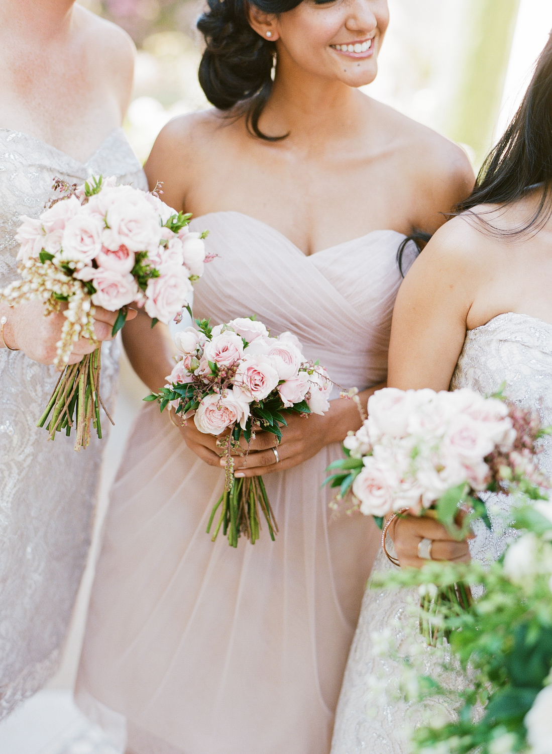 Sweetheart necklines abound with both the bride and her bridesmaids; photo by Sylvie Gil