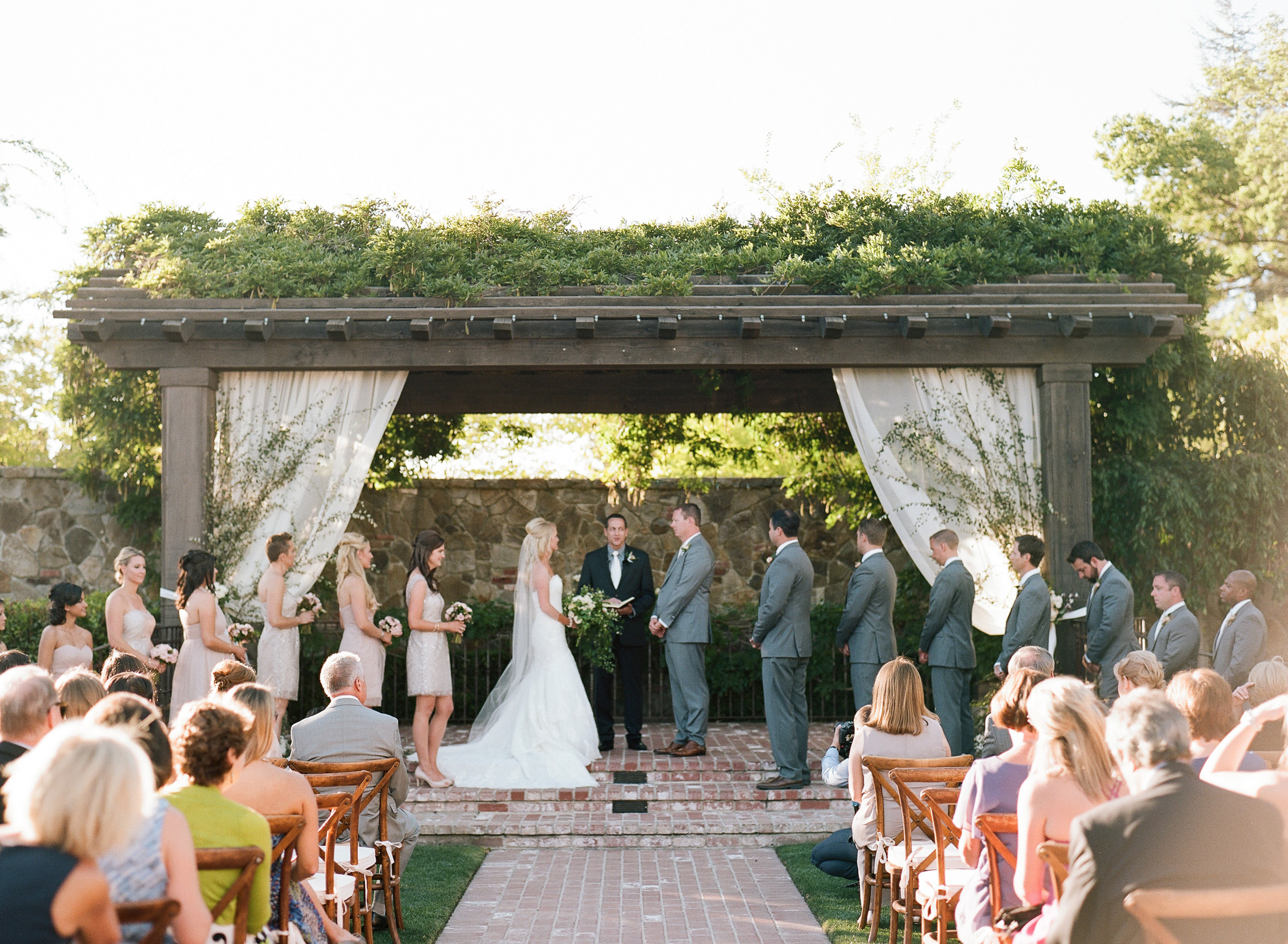 Megan and Brett exchange vows in front of friends and family in their gorgeous Napa venue; photo by Sylvie Gil