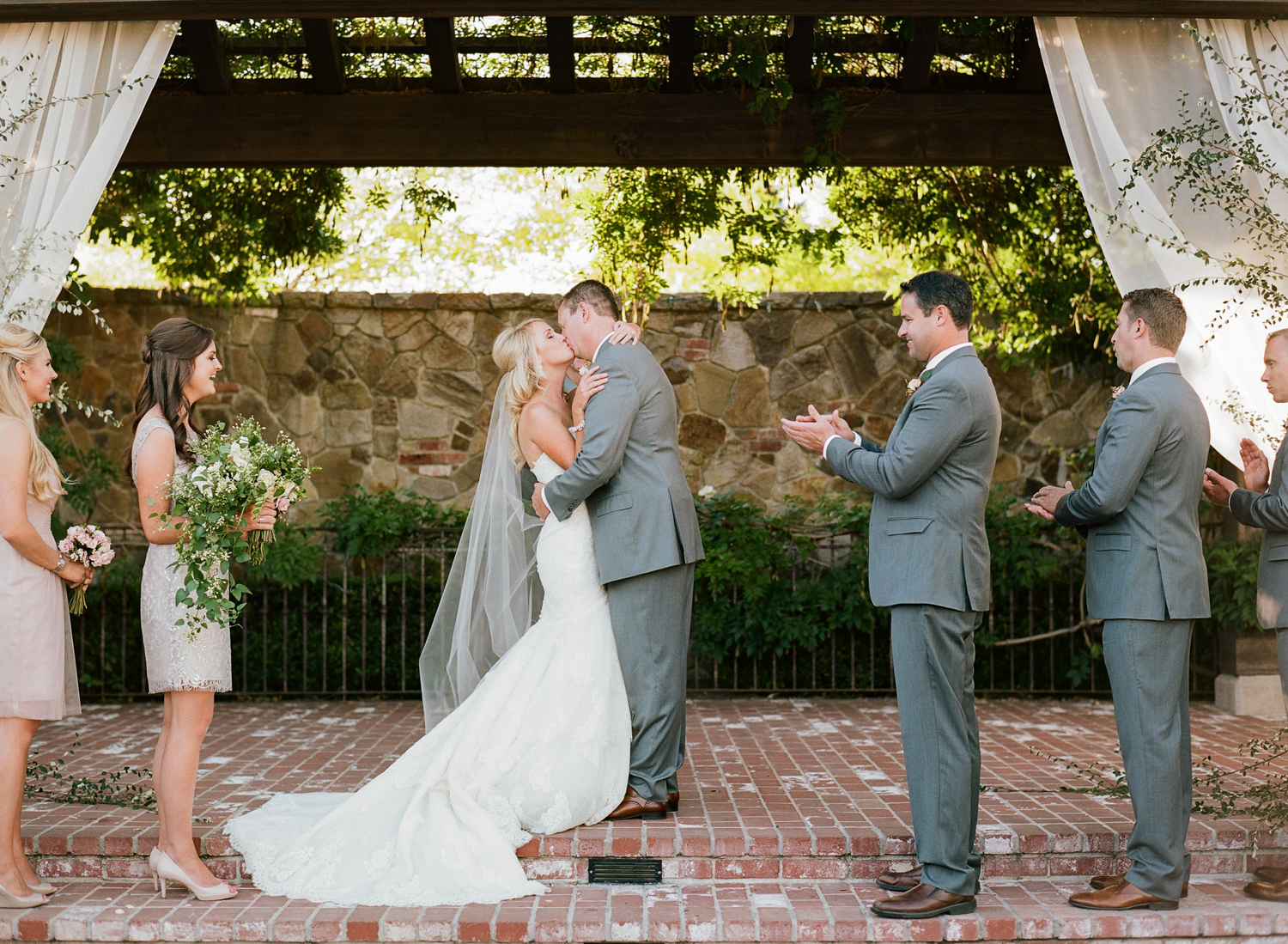 """A romantic kiss after the couple has said """"I do"""" during their Napa ceremony; photo by Sylvie Gil"""