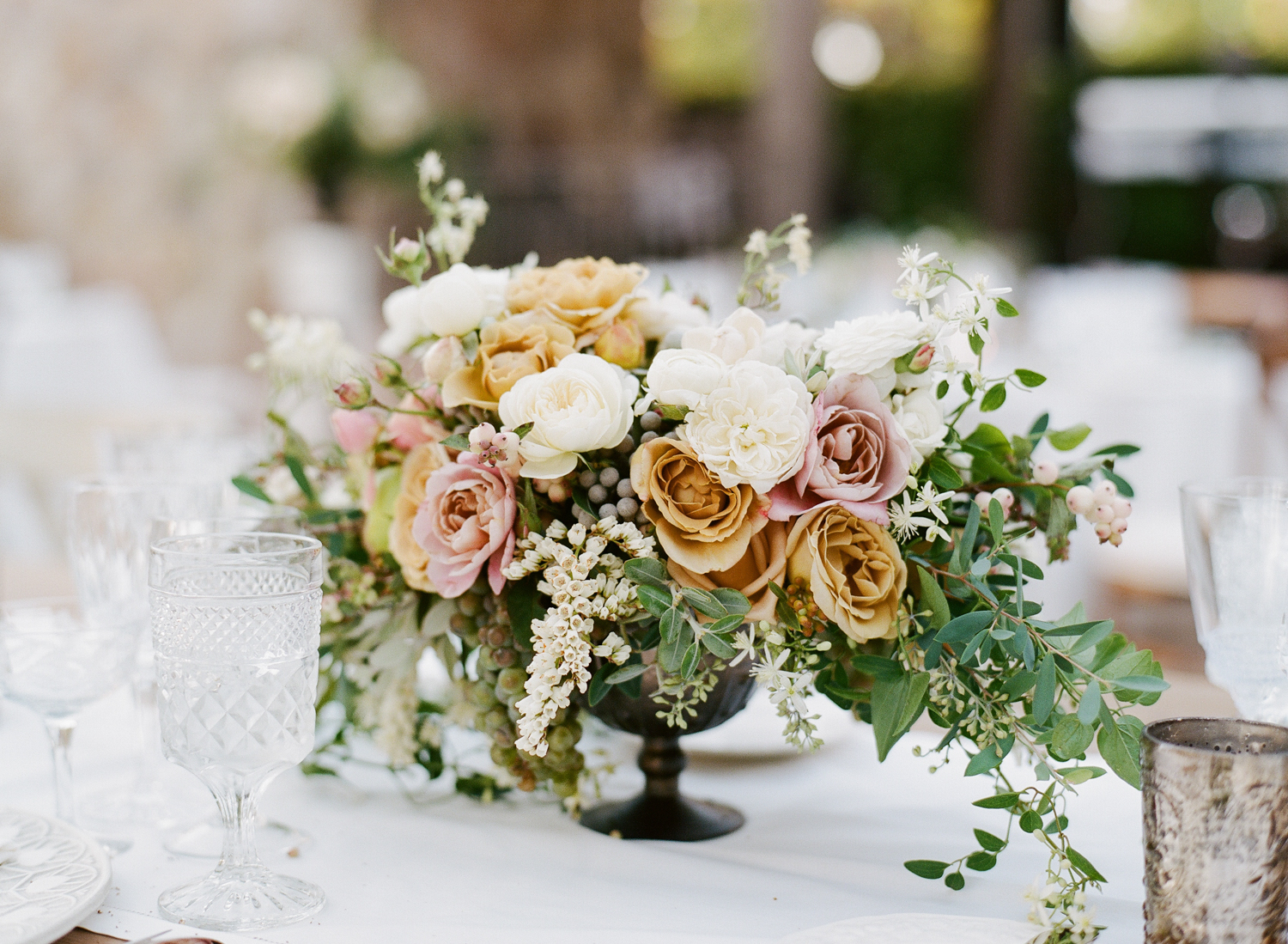 Gold and dusty blush roses make for a unique and elegant centerpiece; photo by Sylvie Gil