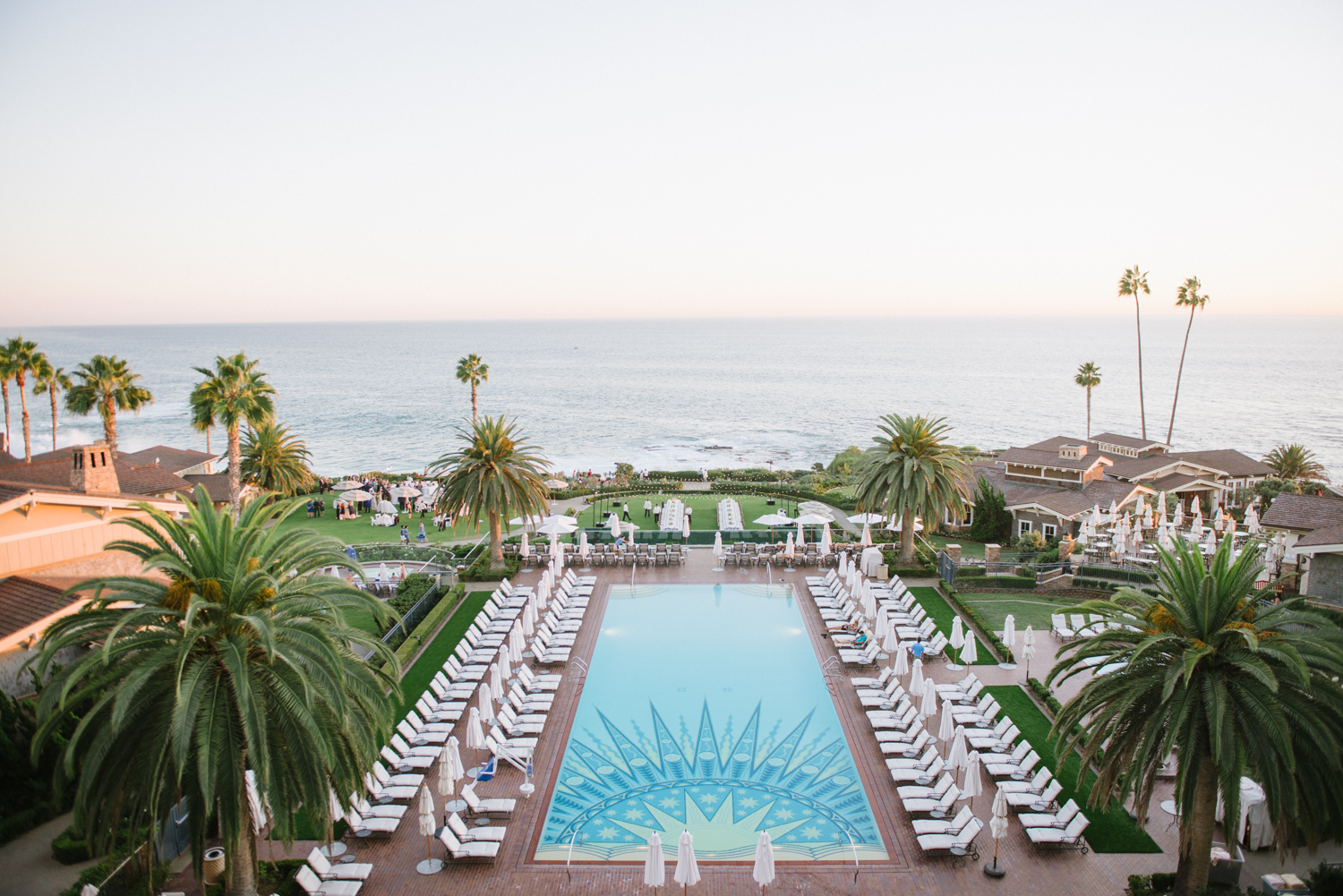 A stunning view from the Ritz Carlton, of the luxurious pool and expansive Pacific Ocean at sunset, a lovely venue for a wedding reception; photo by Sylvie Gil