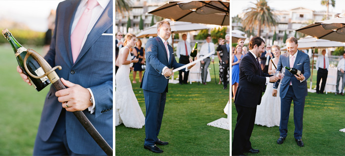 Tanguy opens a bottle of champagne with a saber at the reception - an impressive feat!; photo by Sylvie Gil