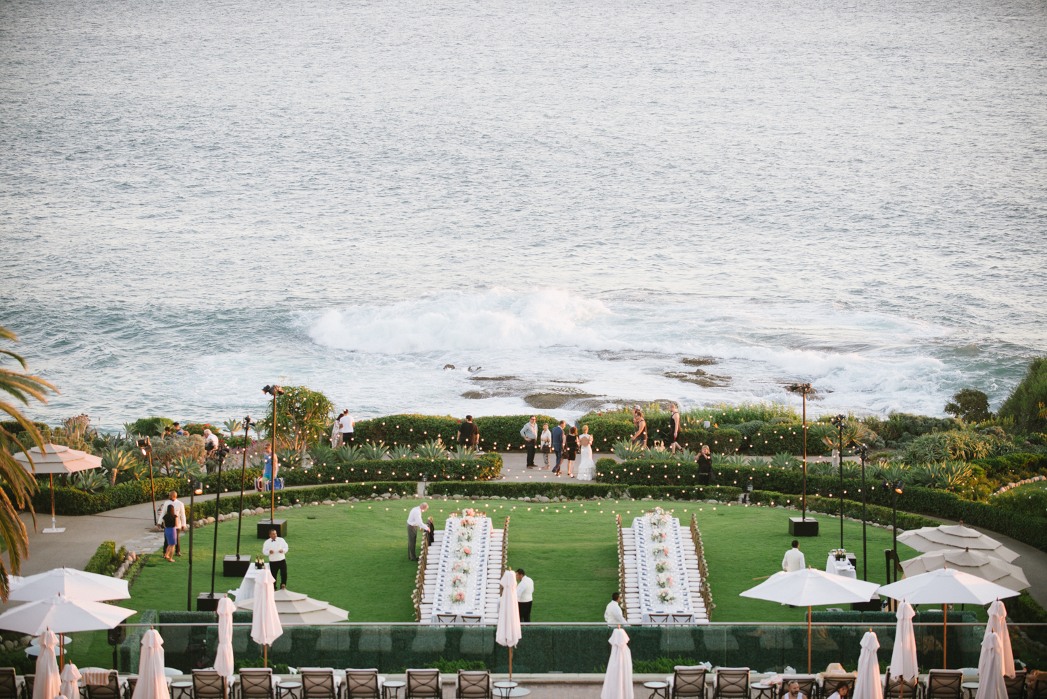 A closer shot of the ocean and luxurious green lawns of the Ritz - Margo & Tanguy mingle with guests at the reception; photo by Sylvie Gil
