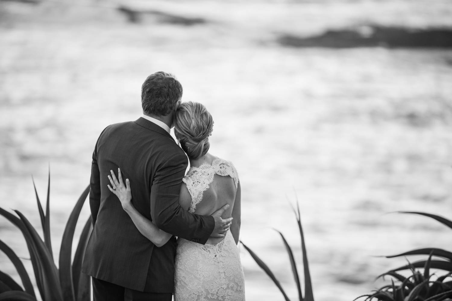 Margo & Tanguy take a moment to look at the ocean on their wedding day, truly a couple in love; photo by Sylvie Gil